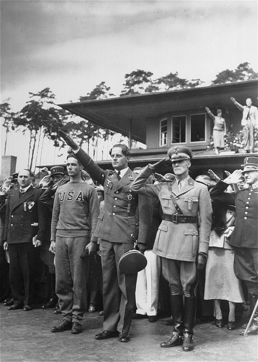 The victory ceremonies of the pentathlon at the 11th Summer Olympic Games.   From left to right, the winners are: Lt. Charles F. Leonard (USA-Silver), Lt. Gotthardt Handrick (Germany-Gold), and Captain Silvano Abba (Italy-Bronze).