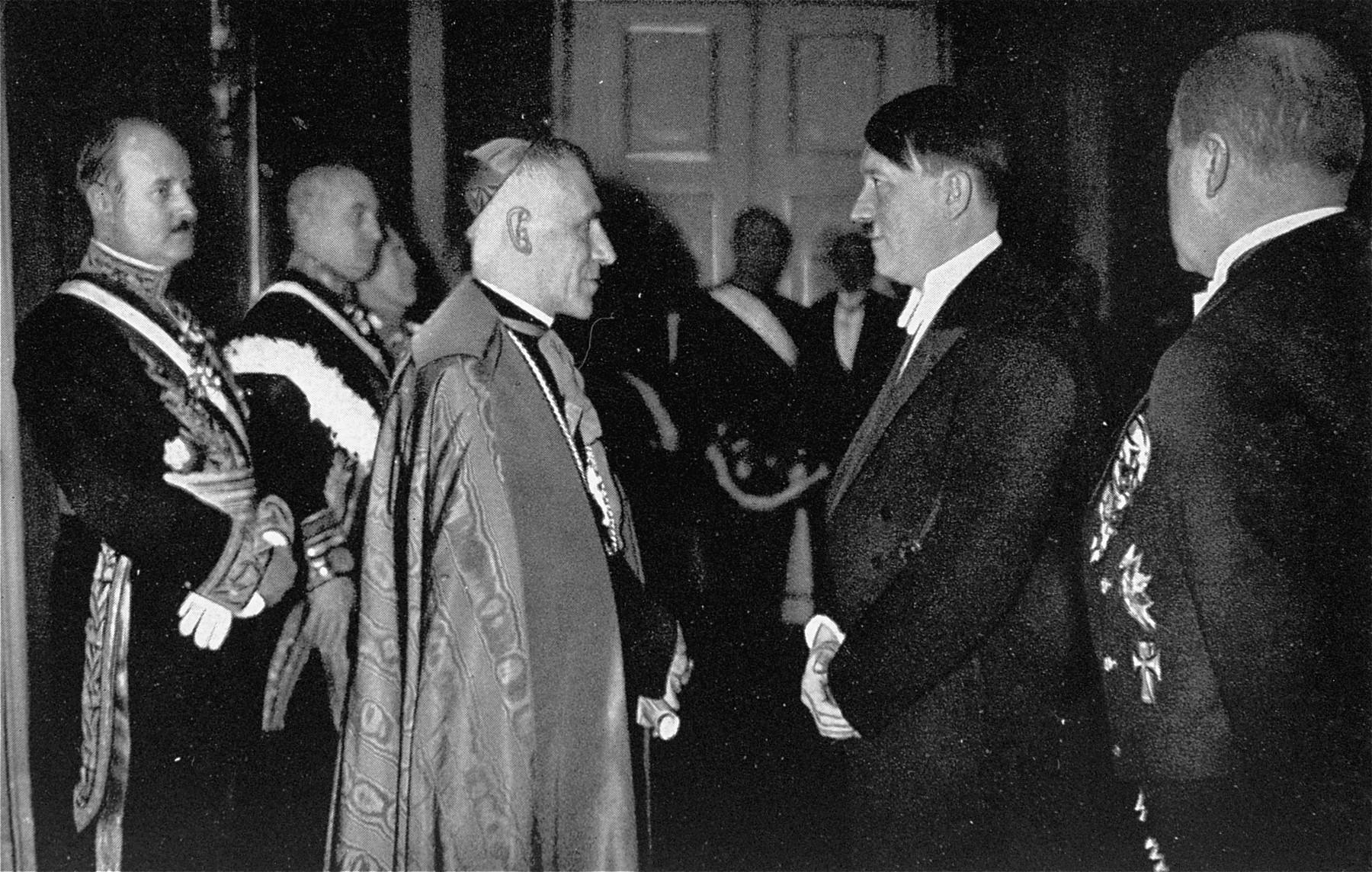Adolf Hitler converses with the Papal Nuncio, Archbishop Cesare Orsenigo, at a New Year's reception in Berlin.