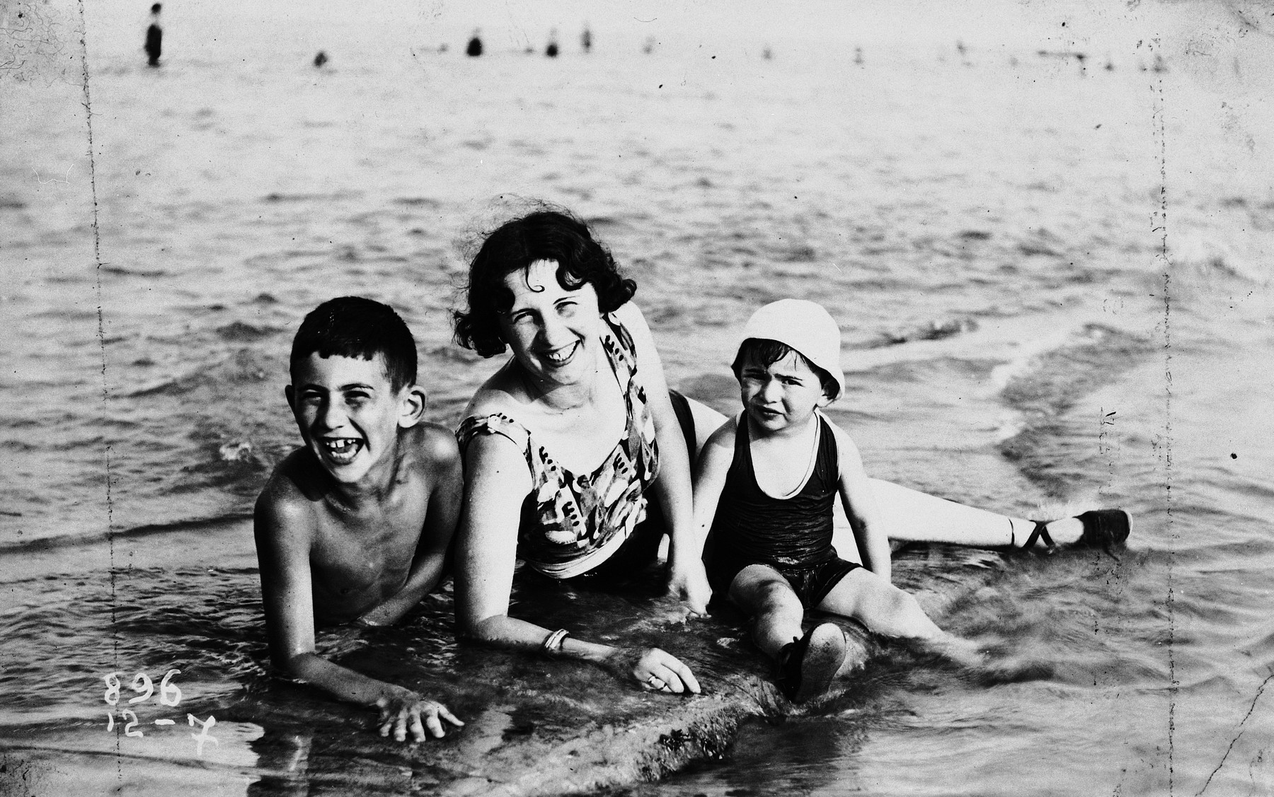 Jenny Porges poses with her two sons, Kurt and Paul Peter, at the beach.