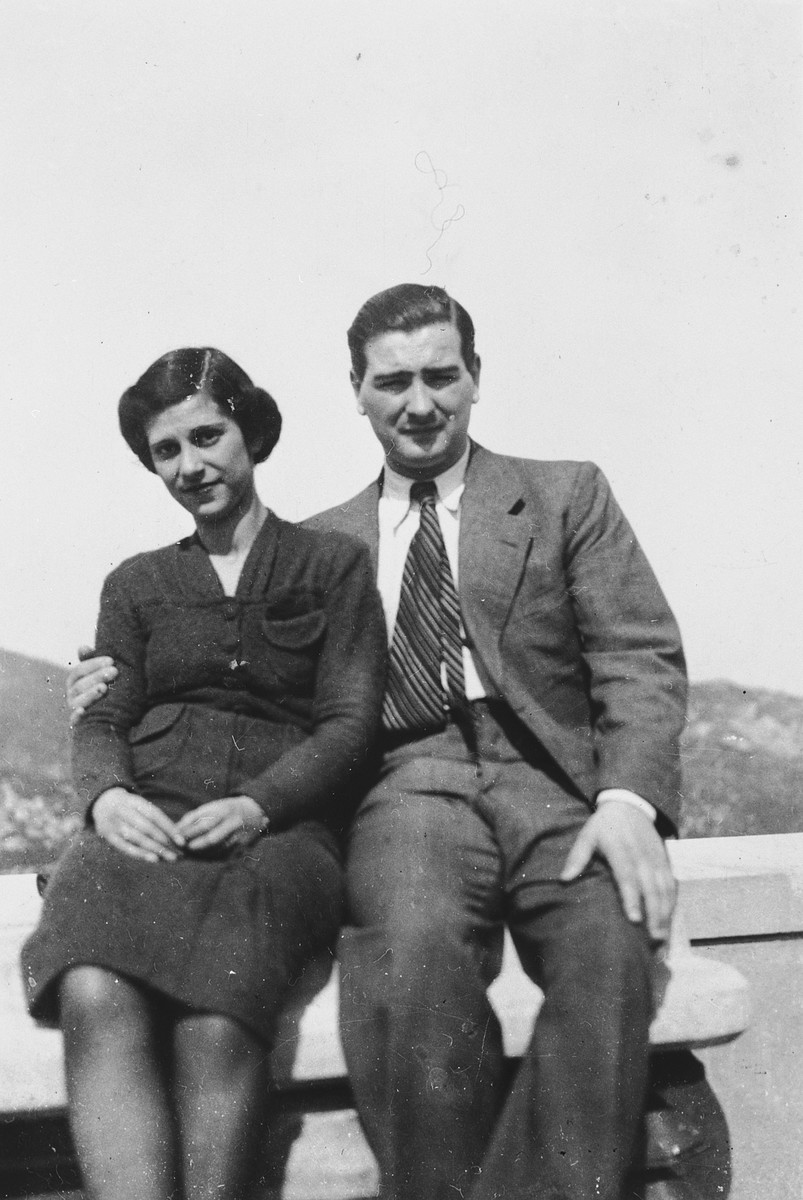 Portrait of Samuel and Liesl Ekerling sitting on an outdoor bench in the United States shortly after they immigrated.  They mailed this photograph back to their parents in Vienna.