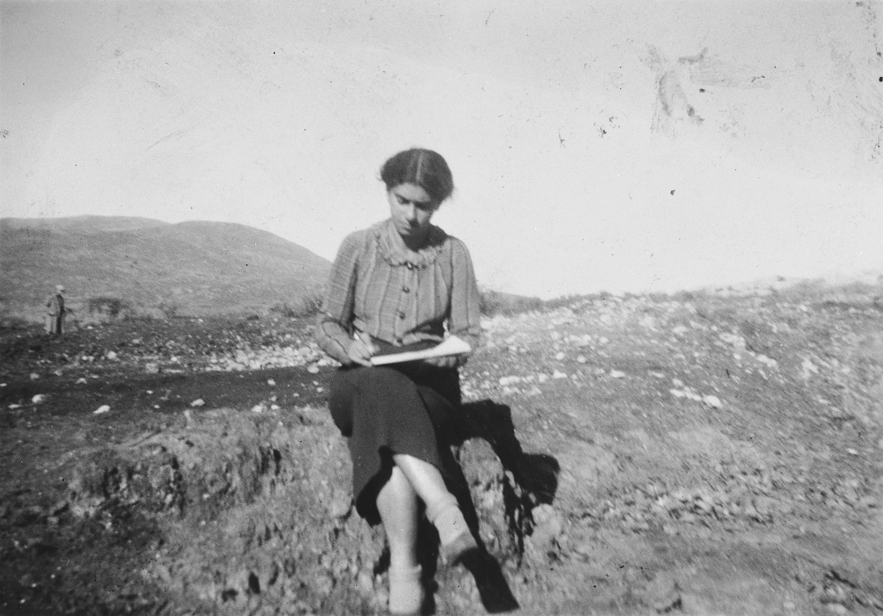 Artist Esther Lurie sketches on the hills outside Beit Alfa in the Galilee.