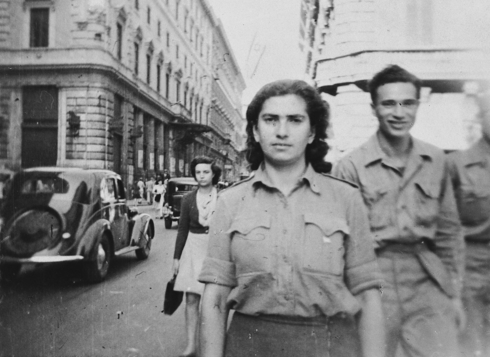 Artist Esther Lurie walks down on a street in Rome following her liberation and prior to returning to Palestine.