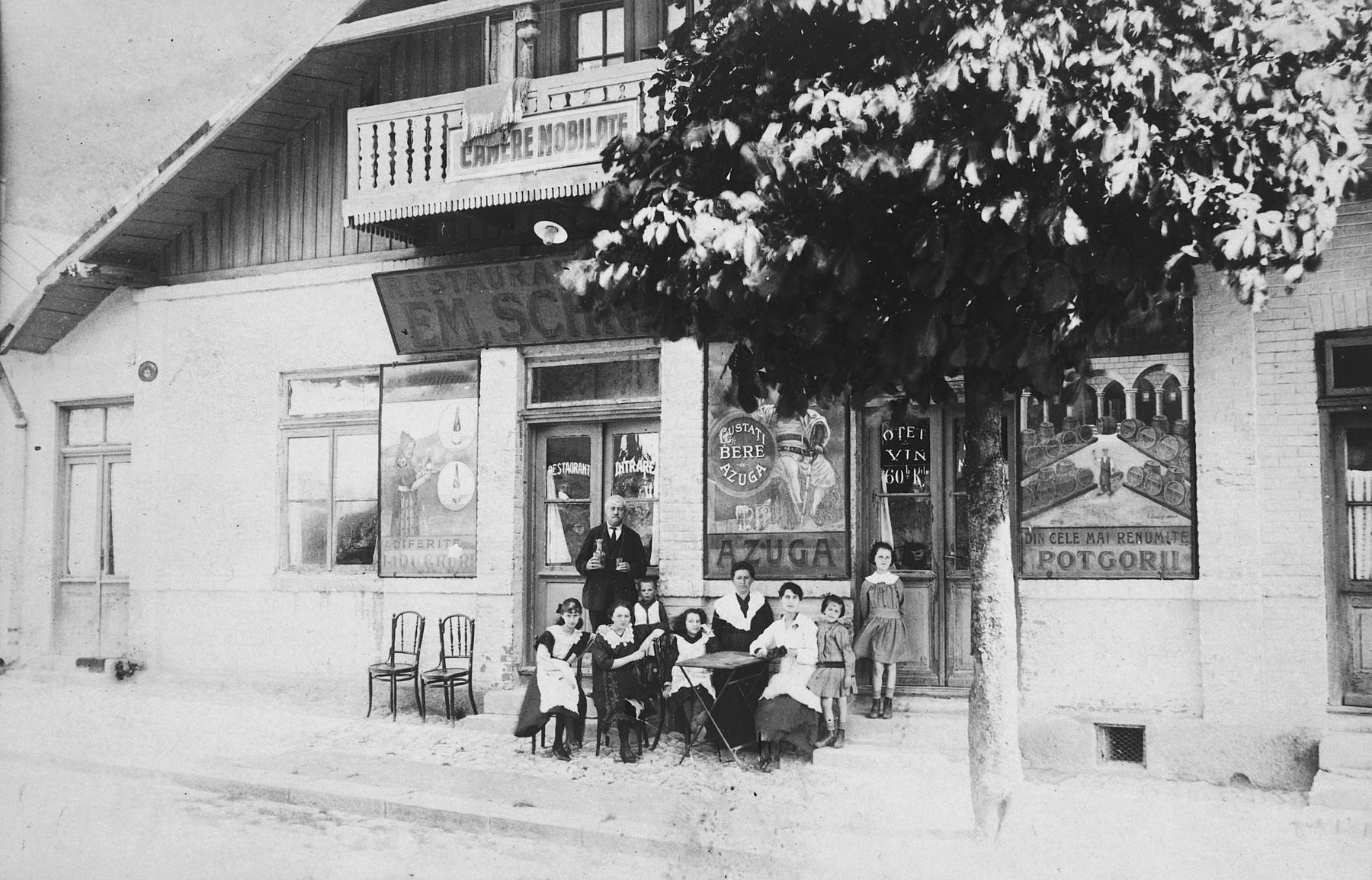 The Schreiber family poses outside their restaurant in Sinaia, Romania.