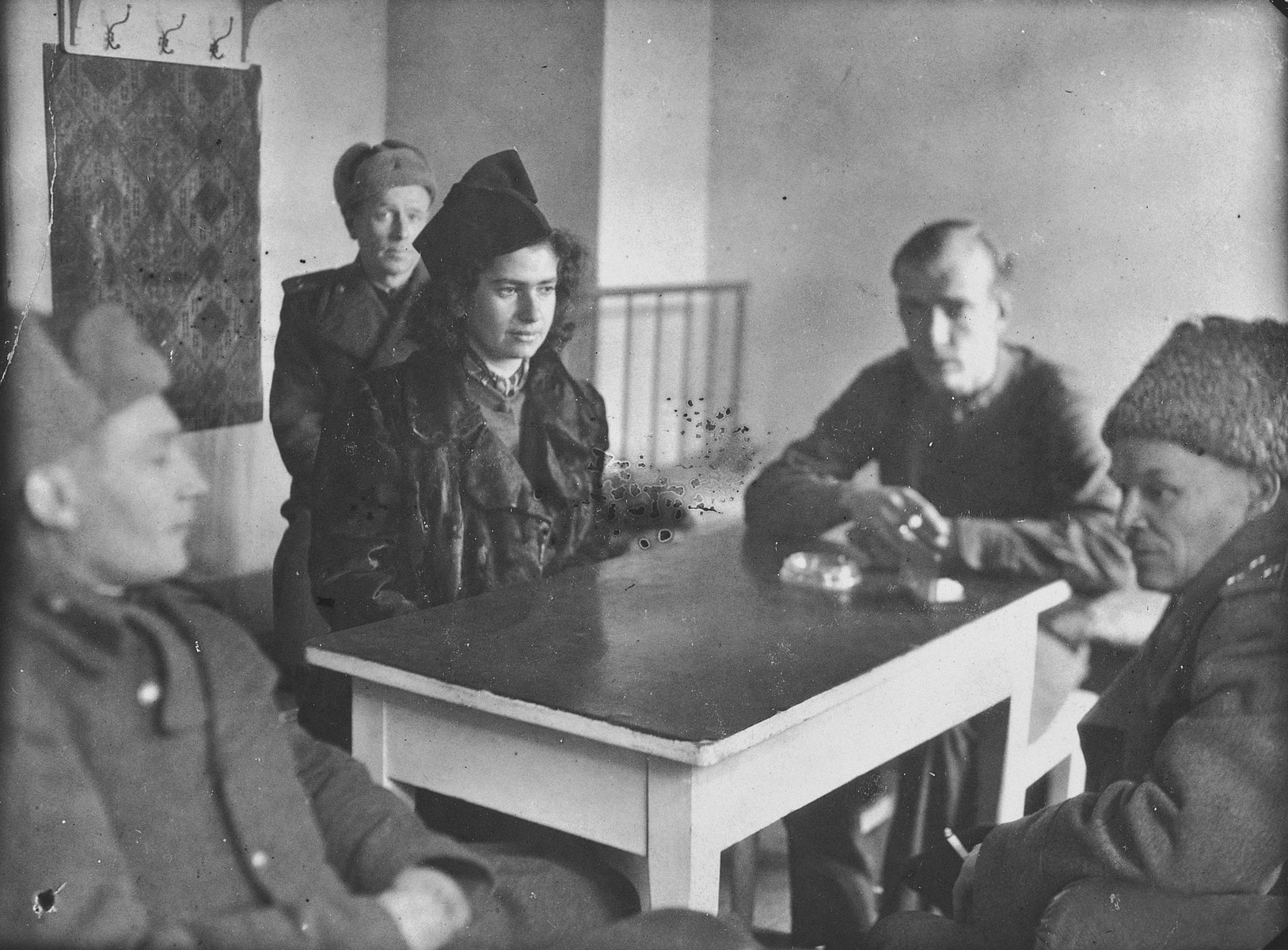 Esther Lurie serves as a translator between freed American POWs and Soviet officers.