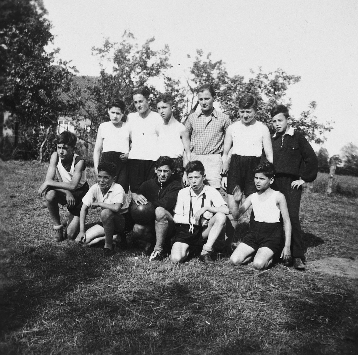 Portrait of a Jewish soccer team in Koenigsberg, Germany.  Among those pictured is Hans Garfunkel, in the dark shirt (front row, center).