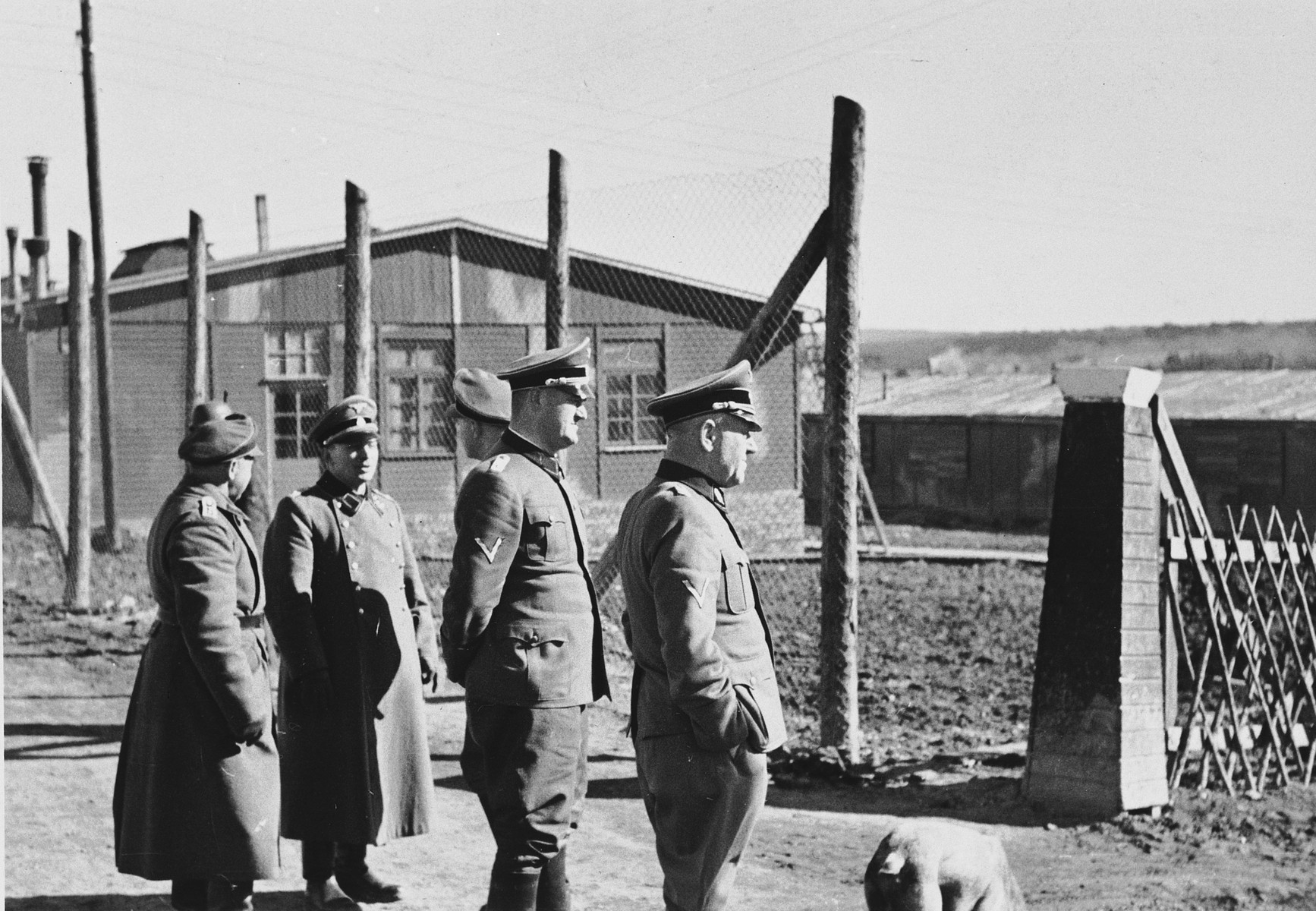 A group of SS officers tour the Hinzert concentration camp.