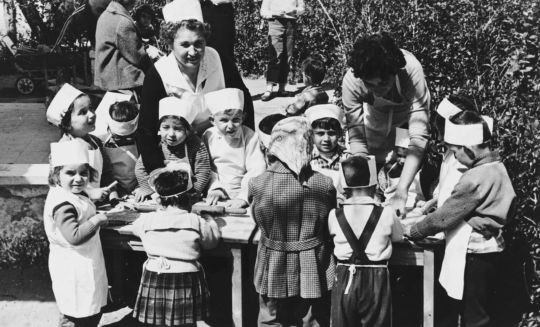 Children in an Austrian-Jewish preschool learn to cook.