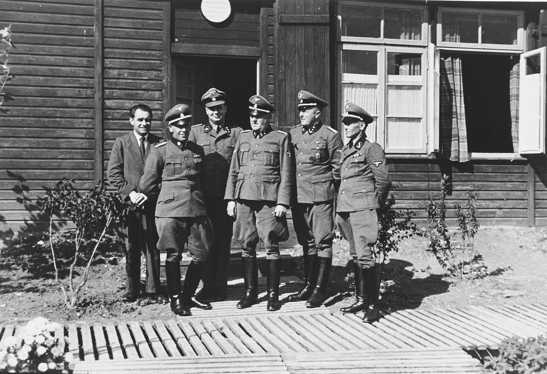 Group portrait of SS officers in front of a barrack in the Hinzert concentration camp.  Pictured on the far right is Anton Ganz.