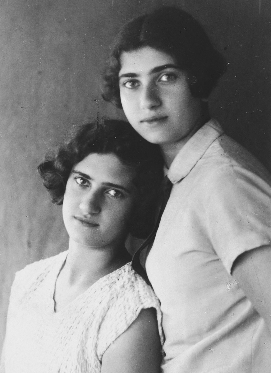 Studio portrait of two Latvian Jewish sisters.  Pictured are Esther Lurie and her sister Shifra.