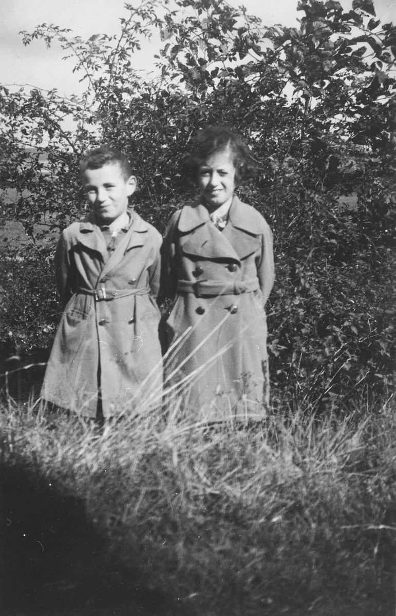 A brother and sister pose in a wooded field near their home in Battenberg, Germany.  Pictured are Norbert and Gisela Eckstein.