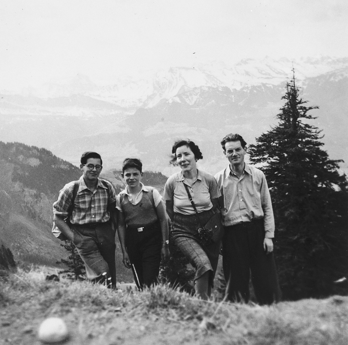 Two Jewish refugee youth pose with the Dym family in the hills outside of Zurich.  Pictured are Hans Garfunkel (far left) and Peter Salz (second from the left).