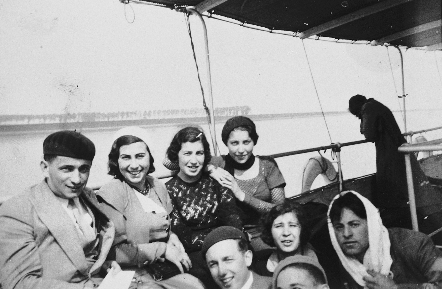 [Students from the Institute of Art in Brussels] enjoy an excursion on a pleasure boat.  Among those pictured are Esther Lurie.