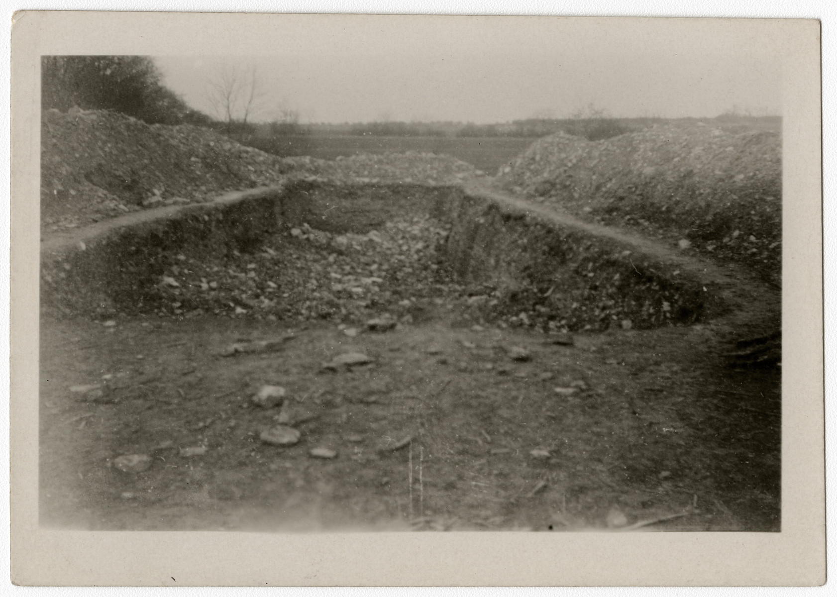 View of a large ditch for mass burials at the Ohrdruf concentration camp.