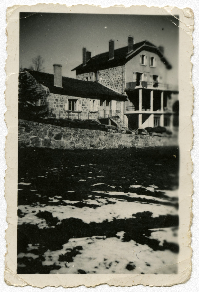 Exterior photograph of a farm house.