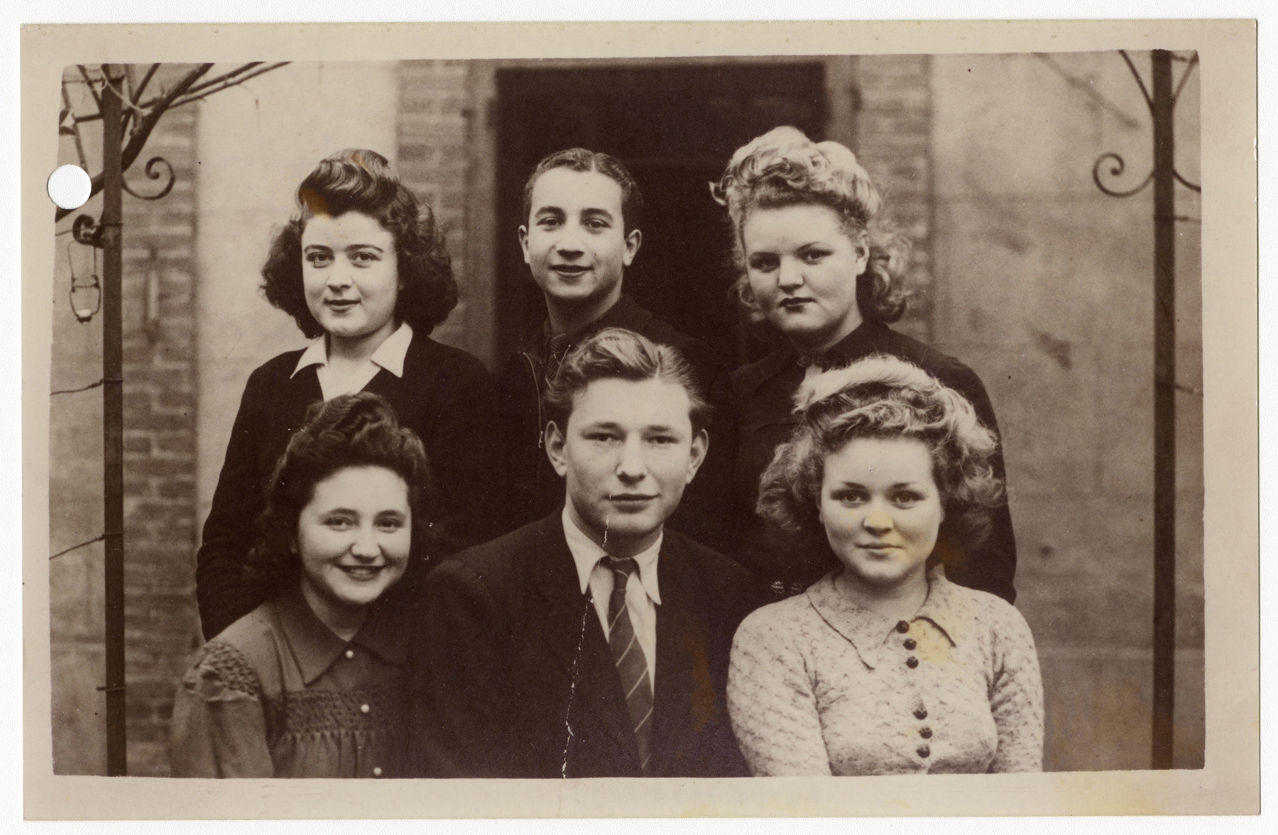Group portrait of Jewish youth in hiding.  Pictured bottom row from right to left are Francine Ajzensztark, Maurice Rubinsztein and Maurice's cousin Suzanne (who did not survive).  Top row, right to left: Suzanne Ajzensztark. Henry (did not survive) and Annette (a Christian girl whose father helped them get false papers and who hid Maurice)  After the war Annette and Maurice married.