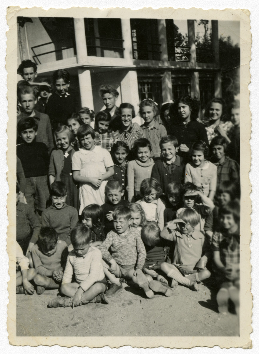 Group portrait of Leah Wajsfelner with other children while she was hiding in France during WWII.  [This may possibly be a postwar children's home.]