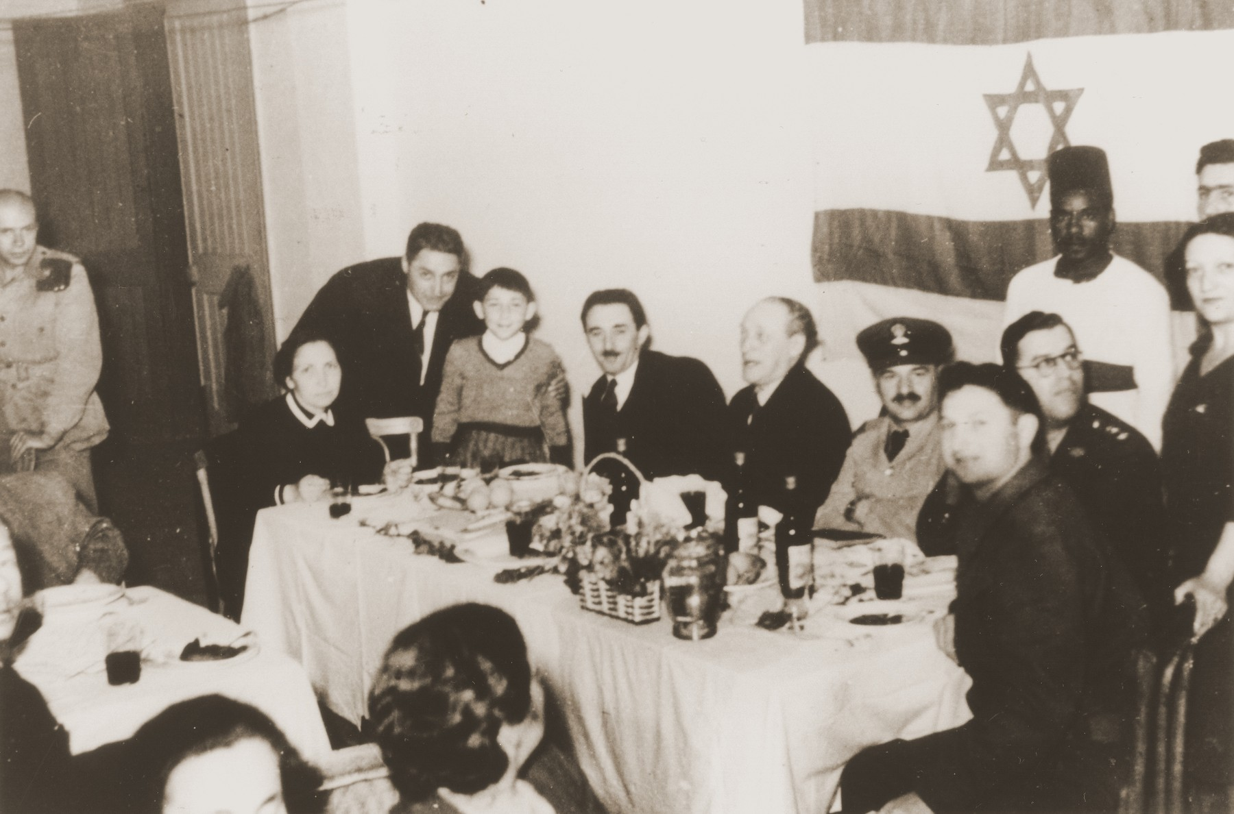 Dinner at the Jewish Soldiers' Club in Cairo.  Seated at the large table from left to right are, Tzipora, Chaim and Moshe Sharett; Dr. Yehuda Eben-Shmuel; Rabbi Israel Brodi; Abba Eban; and Rehavam Amir.