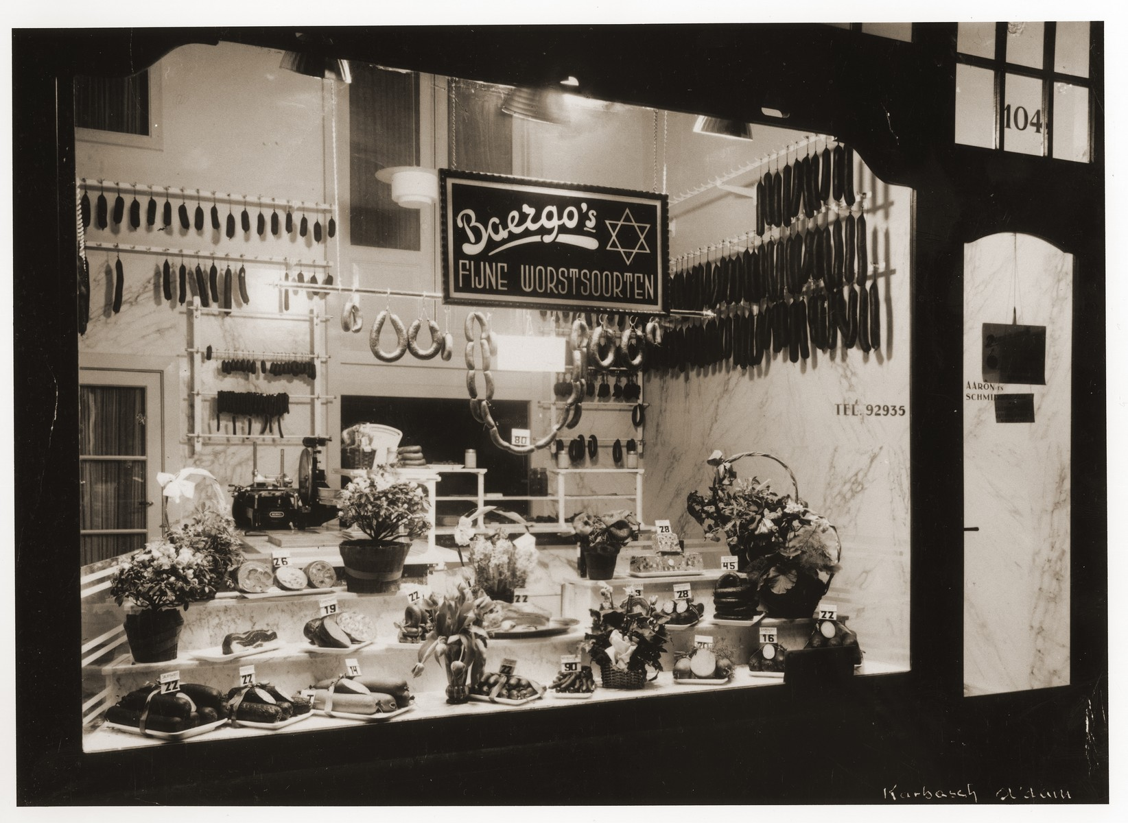 View of the entrance and display window of the Baergo butcher shop in Amsterdam, owned by Ernst Baer, a German Jewish emigre.