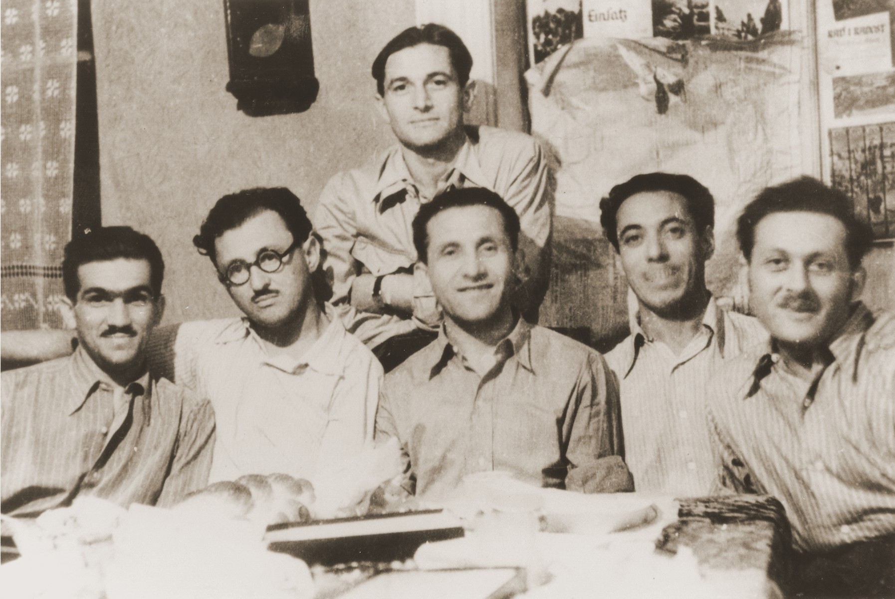 Palestinian Jewish parachutists gather in Bucharest to celebrate the release of Arieh Lupesko and Yehuda Gokovsky from captivity.  Seated from left to right are Arieh Lupsesko, Yitzchak Ben-Efraim, Yeshayahu Trachtenberg, Baruch Kamin, and Yehuda Gokovsky.  Standing behind is Dov (Berger) Harari.