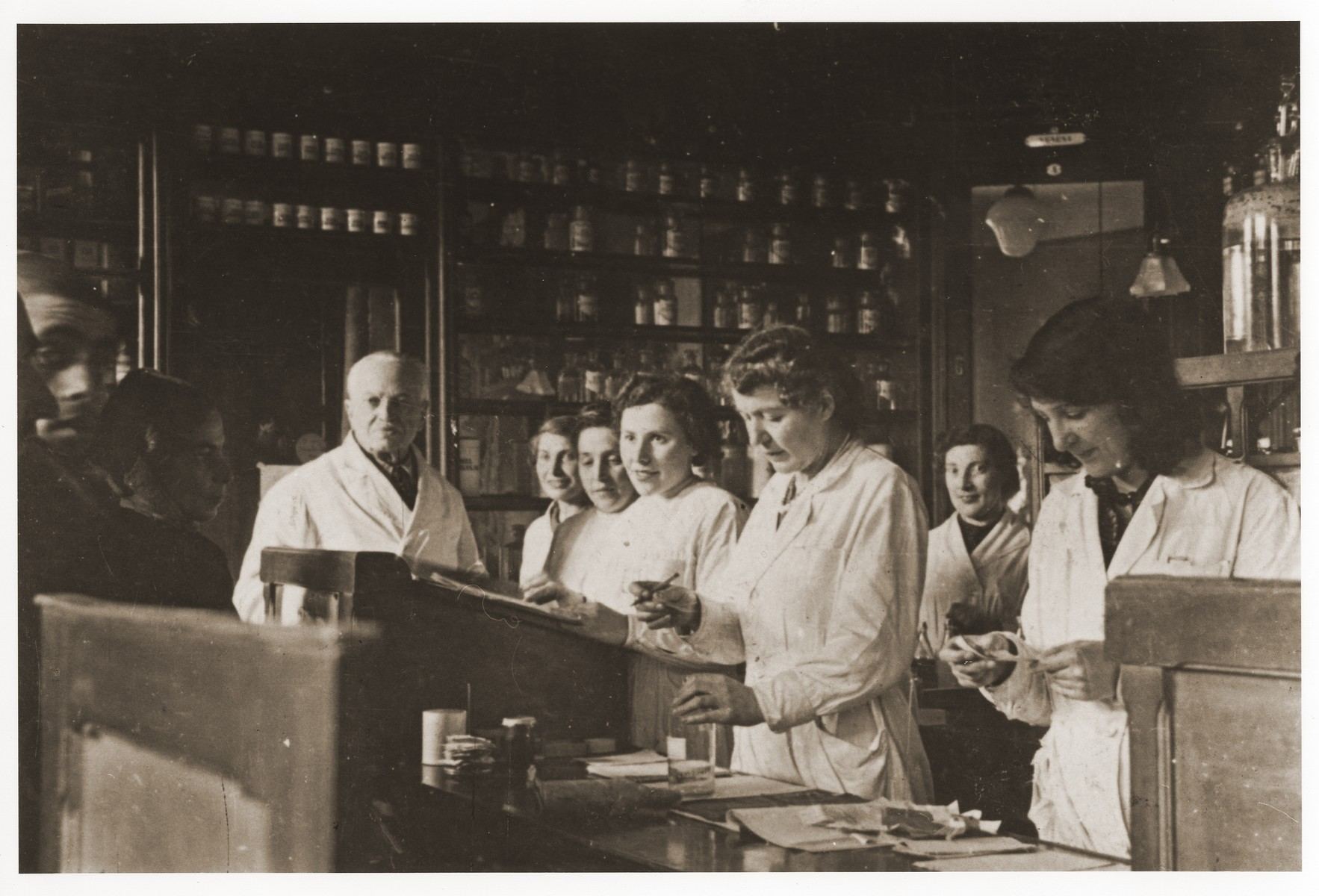 A team of pharmacists at work in the Lodz ghetto pharmacy.