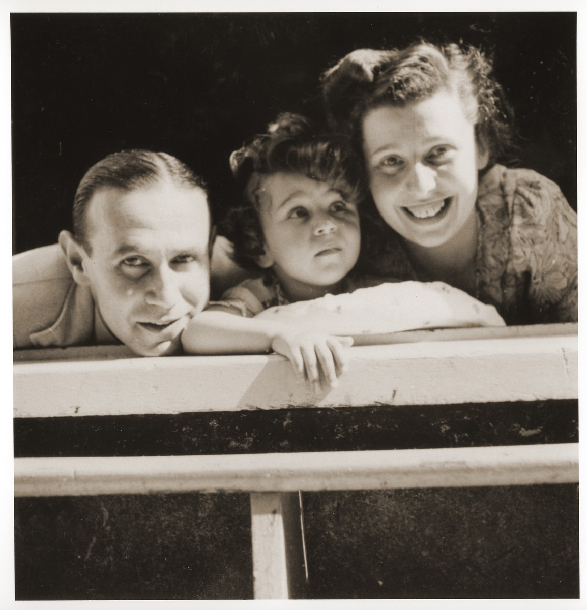 Two-year-old Lore Baer with her parents, Ernst and Edith Baer in their home in Amsterdam.