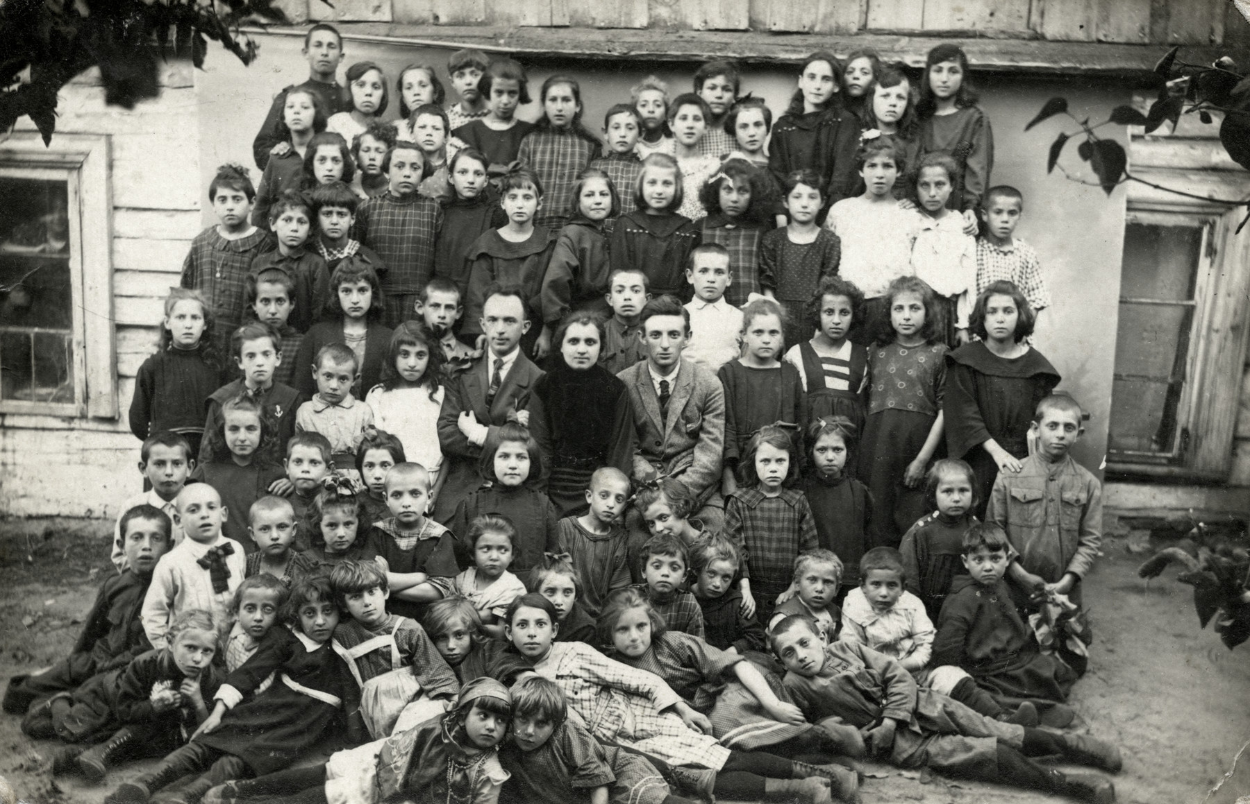 Group portrait of children in a school in Utena (Utian).  Chana Rudashevsky is pictured in the third row, on the far right.