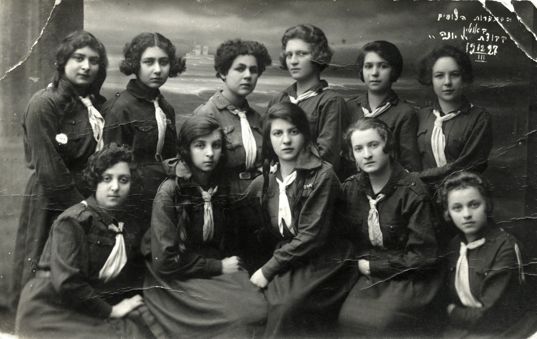 Group portrait of teenage girls in a Jewish scout unit in Utena.  Chana Rudashevsky is pictured in the top row, second from the right.