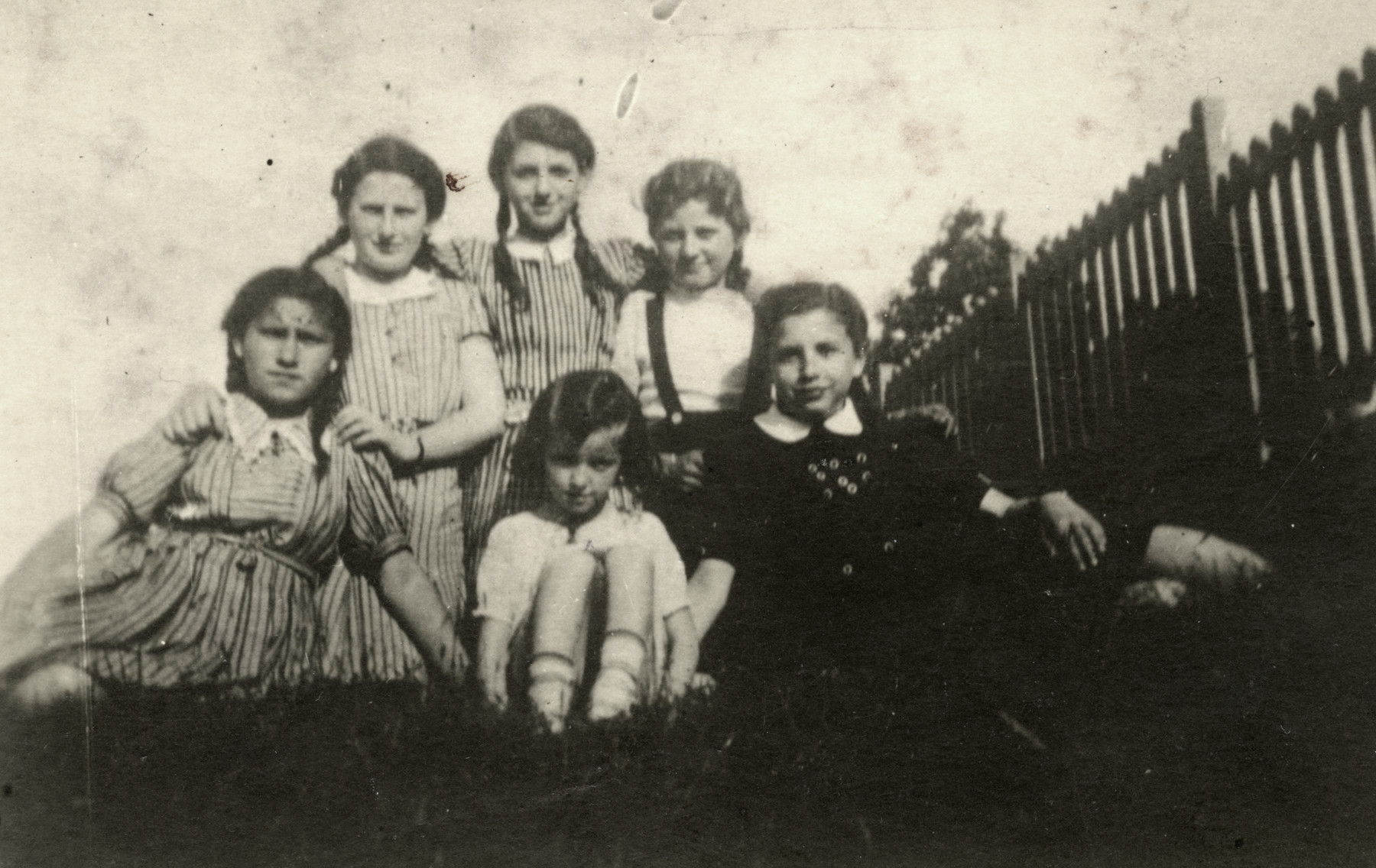 Group portrait of young Jewish girls in Chrzanow.  Among those pictured are Tova Lamm (second from right), Blanche (Blima) Ferber (back row, center), and Leah Ferber (front, center).