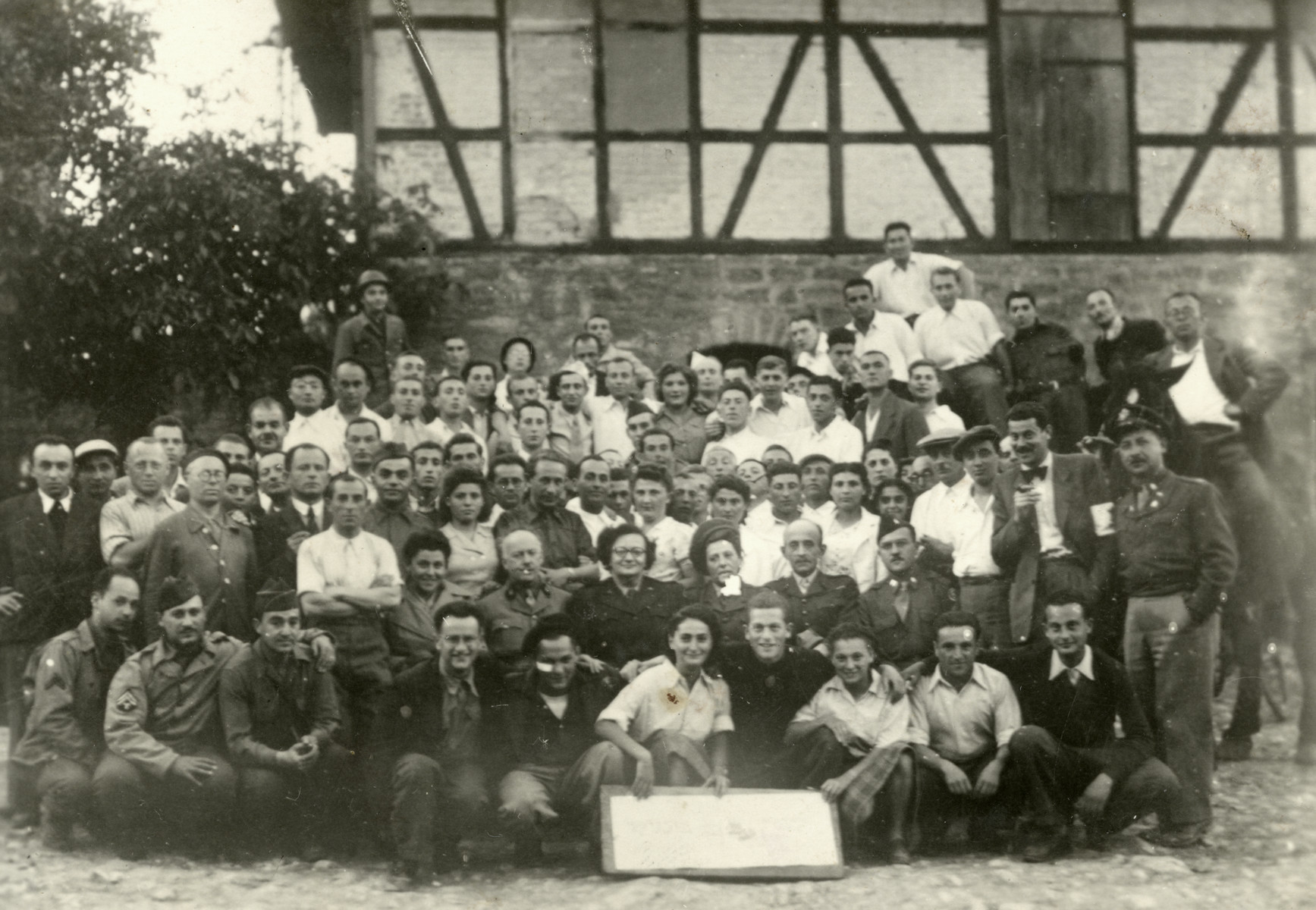 Group portrait of Zionist youth and American soldiers in Kibbutz Buchenwald