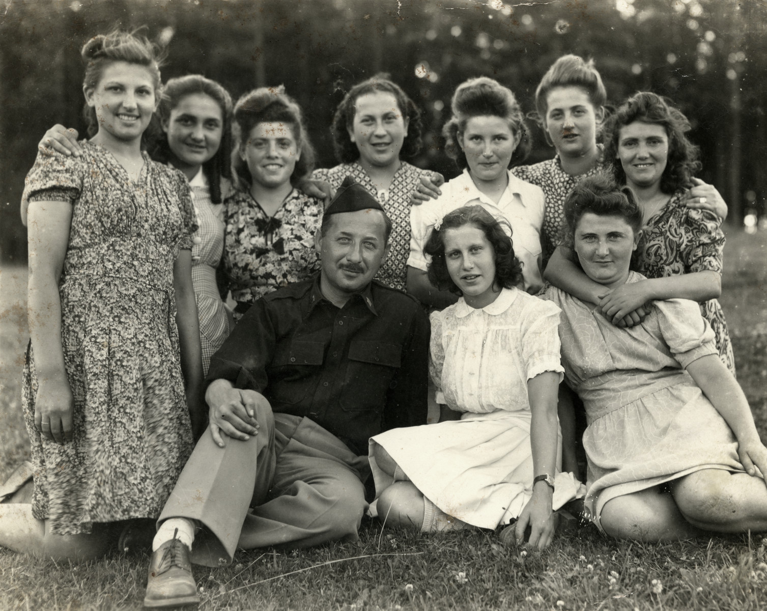 Rabbi Robert Marcus poses with young women from Kibbutz Buchenwald.   Mali Lamm is third from right in the top row.