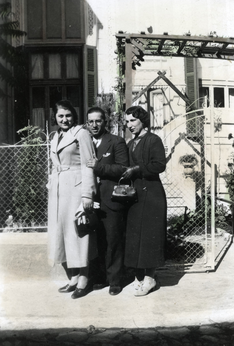 Moise Cassorla poses with two of his sisters on a street of Bitola.