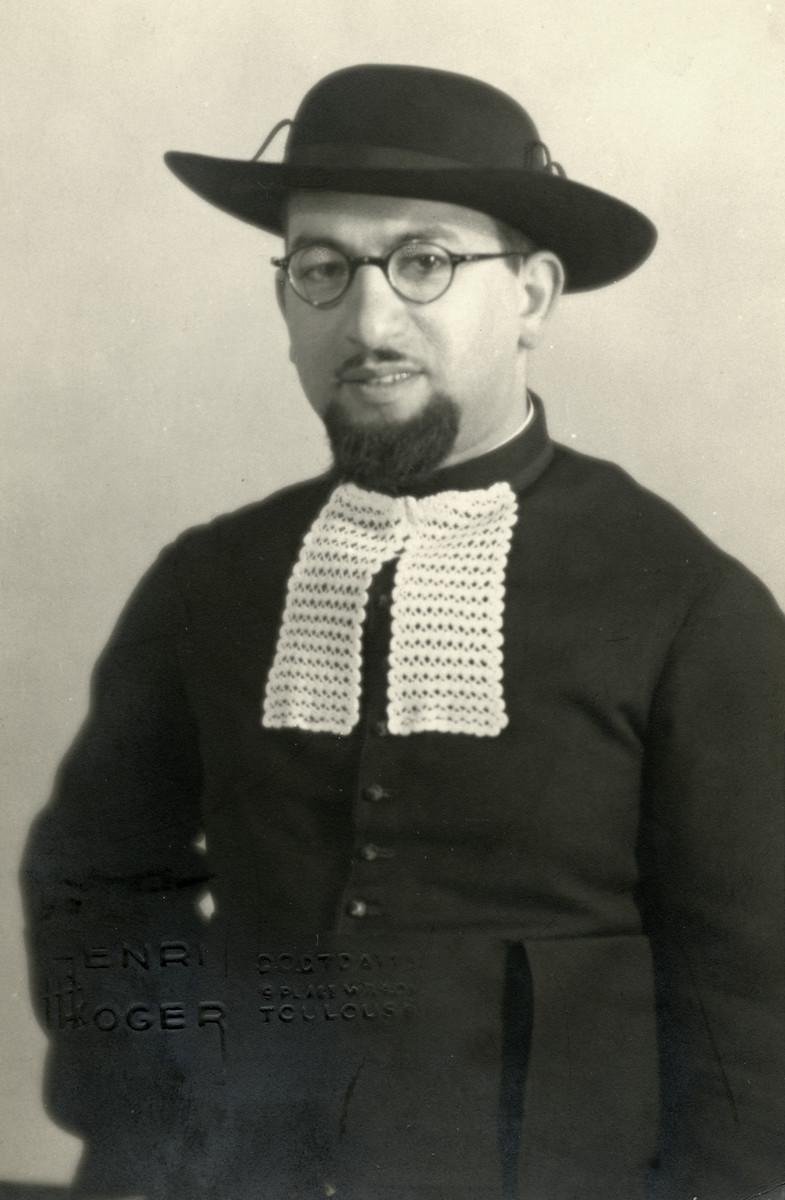 Studio portrait of Rabbi Moise Cassorla (father of the donor) in rabbinical attire.
