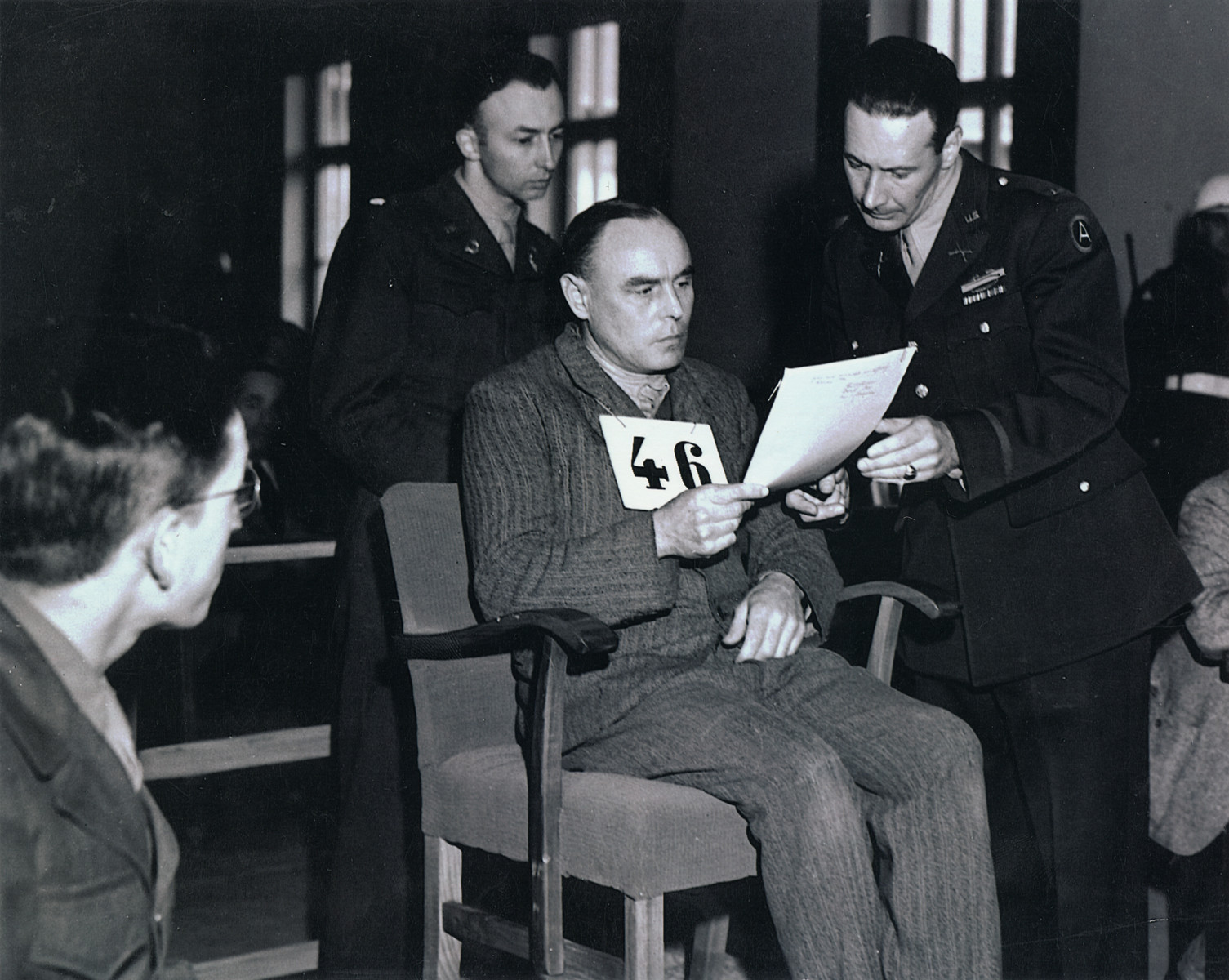 Defendant Vincenz Nohel reads his statement at the Mauthausen war crimes trial.  He was later sentenced to death by hanging.