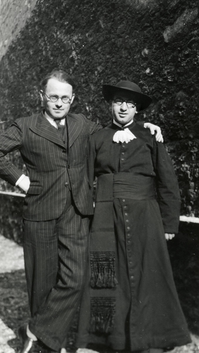 Rabbi Moise Cassorla (father of the donor, on right) poses in full rabbinical attire with an unknown person in a suit.