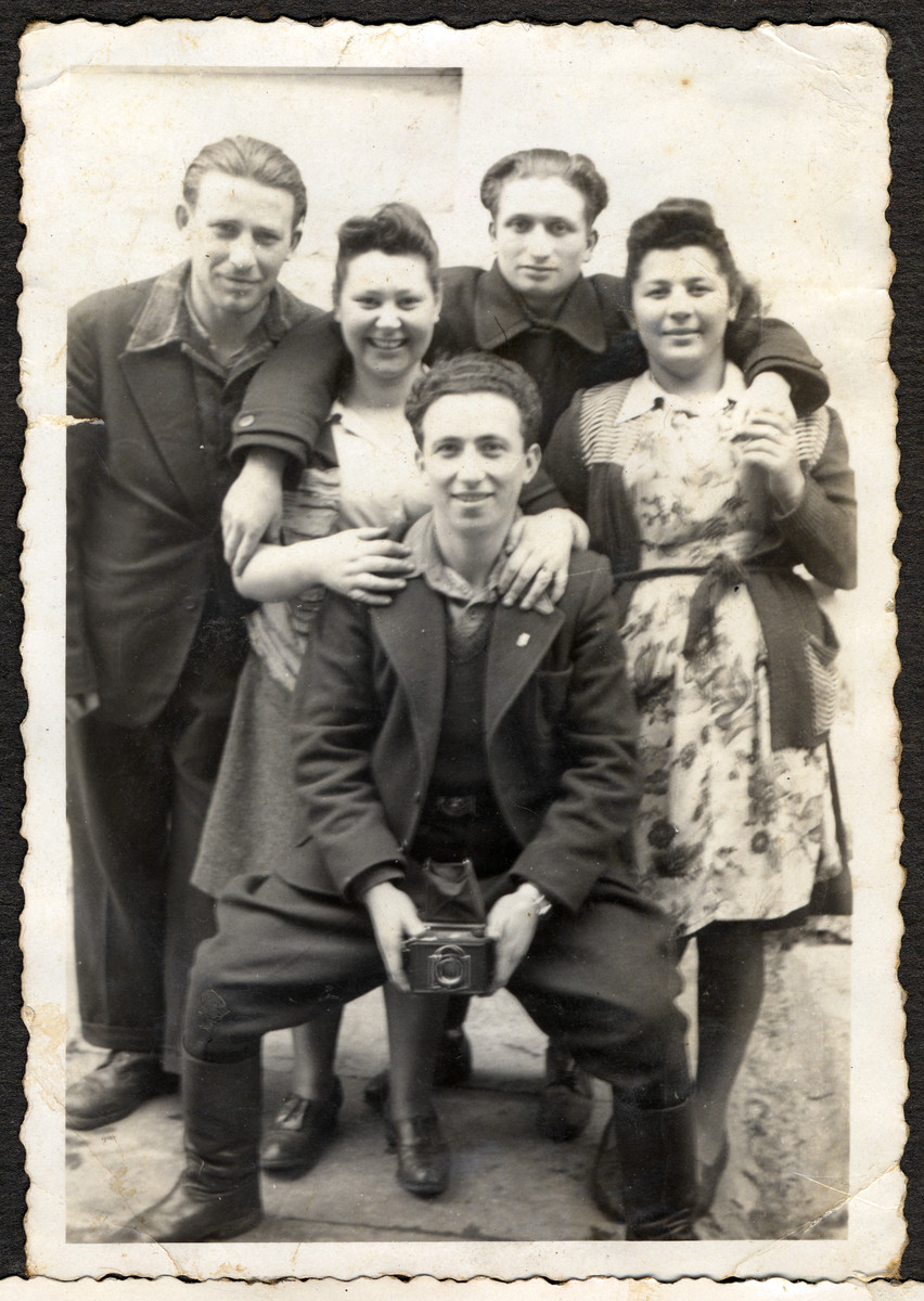 Group portrait of Jewish youth after the war in Lodz.   Pictured from the left are: unknown, Rachel Grynglas, Lolek Grynfeld (holding the camera), Abram Zelig and Renia Klugman.