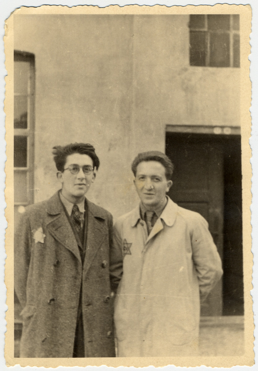 Close-up photograph of two young men wearing Stars of David in the Lodz ghetto.