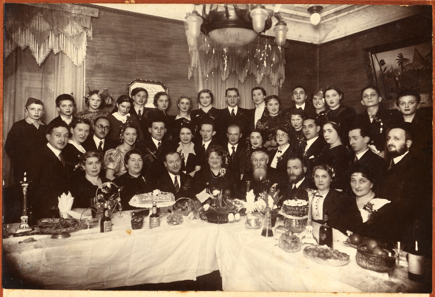 Group portrait of Jews celebrating a golden wedding anniversary.    Pictured in the center are Michuel Yidl and Brandla Krell (the donor's maternal grandparents) who were celebrating their fifteenth wedding anniversary.