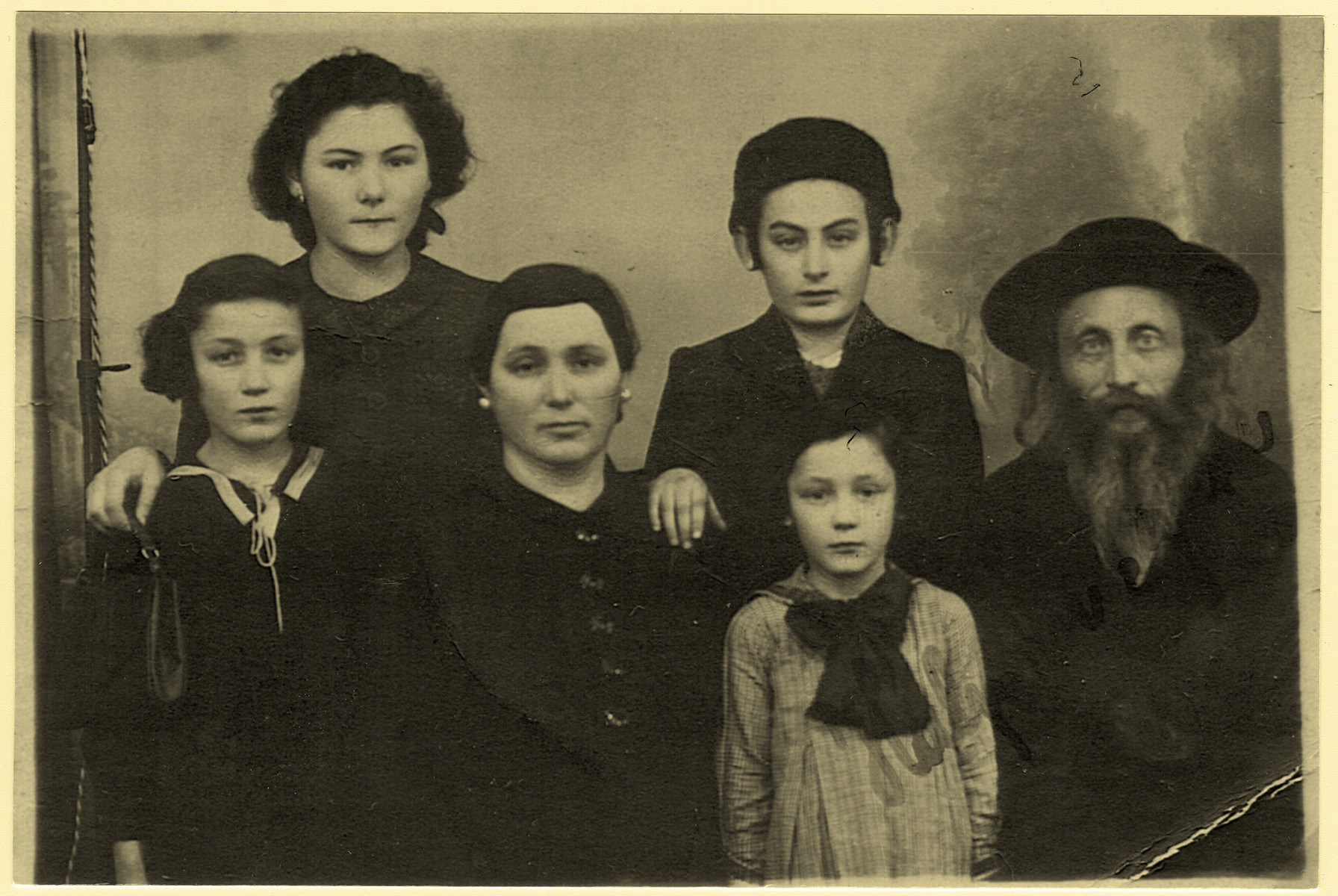Prewar studio portrait of the Halpern family.  Pictured from left to right are Pnina, Leah, Malka, Meir, Miriam and Yitzchok Halpern.