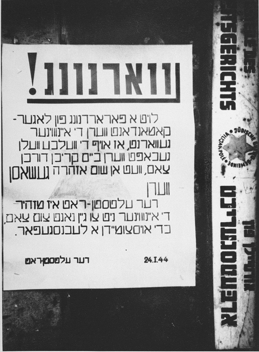 "An announcement in Yiddish posted by the Jewish Council of the Kovno ghetto, dated January 24, 1944, warning ghetto residents against approaching too close to the ghetto fence.    The Yiddish text reads: "" Warning!  By an order of the camp commandant the inhabitants are warned that if they receive any [goods] through the fence they will be shot without warning. The Jewish Council warns the residents not to go close to the fence in order to avoid being killed."""