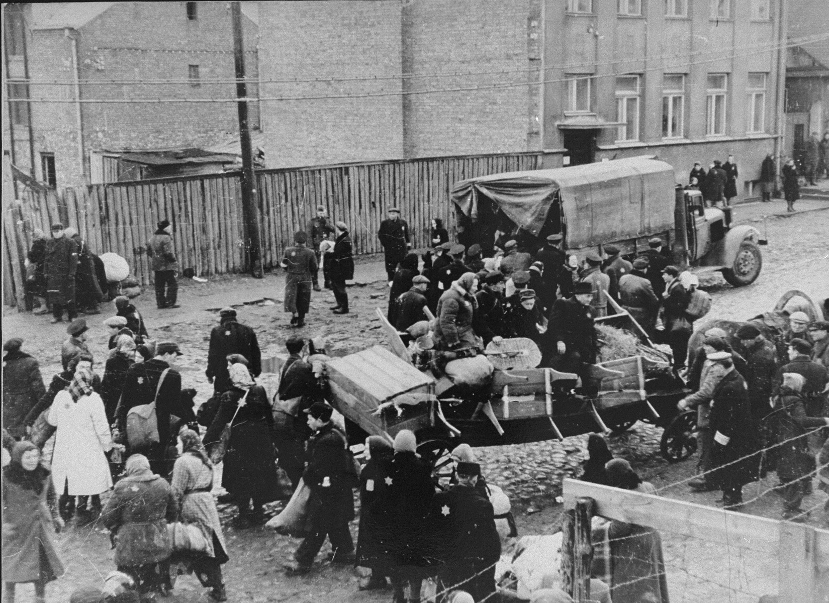 Jews in the Kovno ghetto are boarded onto trucks during a deportation action to Estonia.