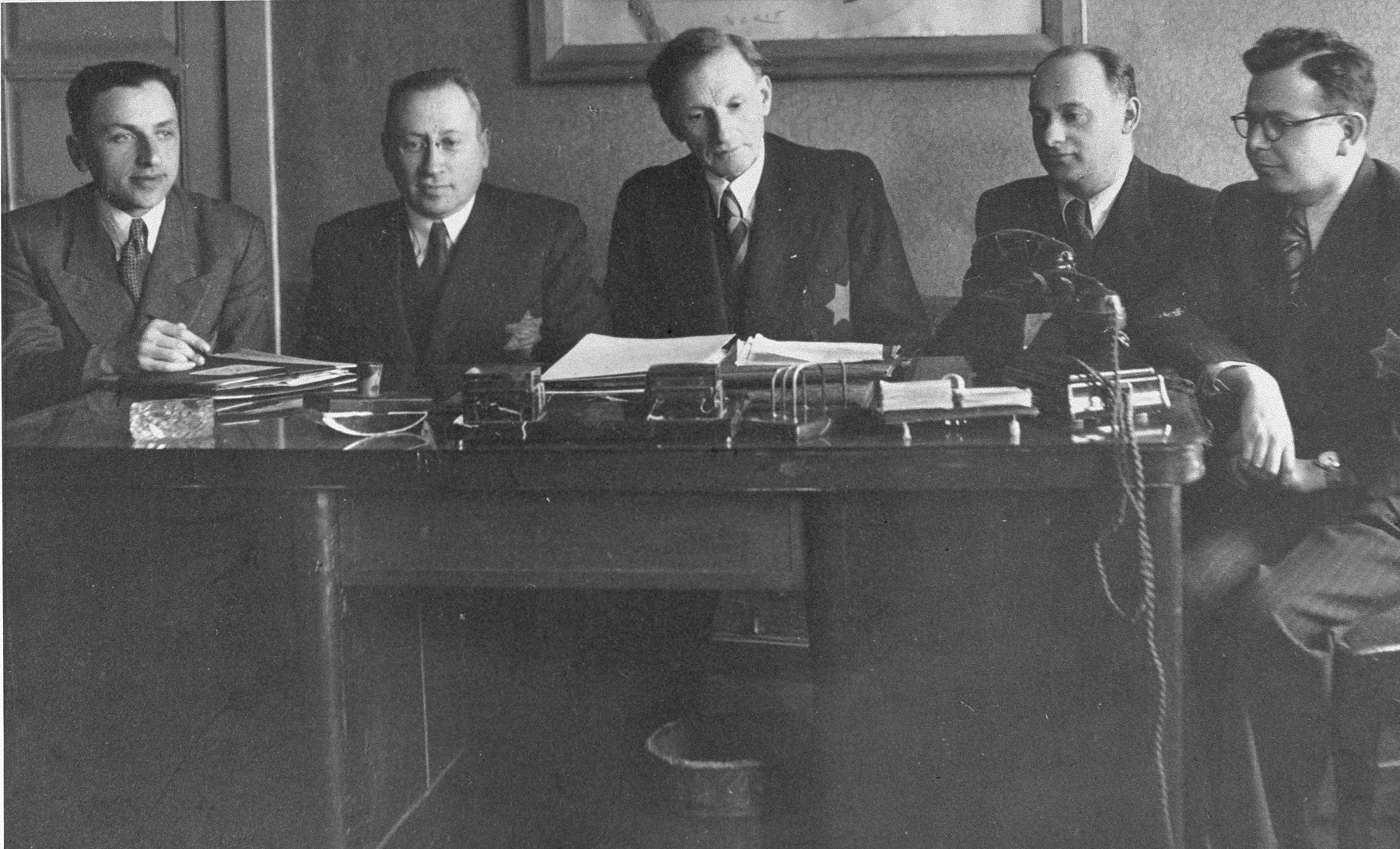 Members of the Kovno Altestenrat (Council of the Elders).  Left to right are Avraham Tory secretary; Leib Garfunkel, deputy chairman; Elkhanan Elkes, chairman; Yakov Goldberg, head of the Labor Office and Zvi Levin, advisor and link with the underground.