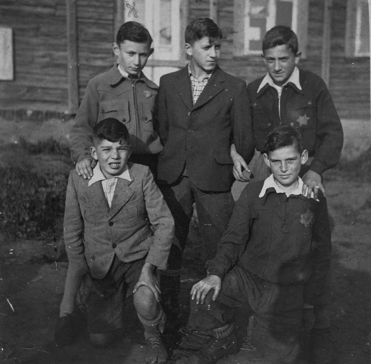 "Five youths in the Kovno ghetto.  The Yiddish inscription on the back reads: ""To the memory of five friends: I. Shapiro, Sh. Katz, R. Schwartzbard, L. Doneshewsky, I. Trozki/ Viljampolie [Slobodka] ghetto.""  Pictured on the left is Itzhak Zeev Trozki."