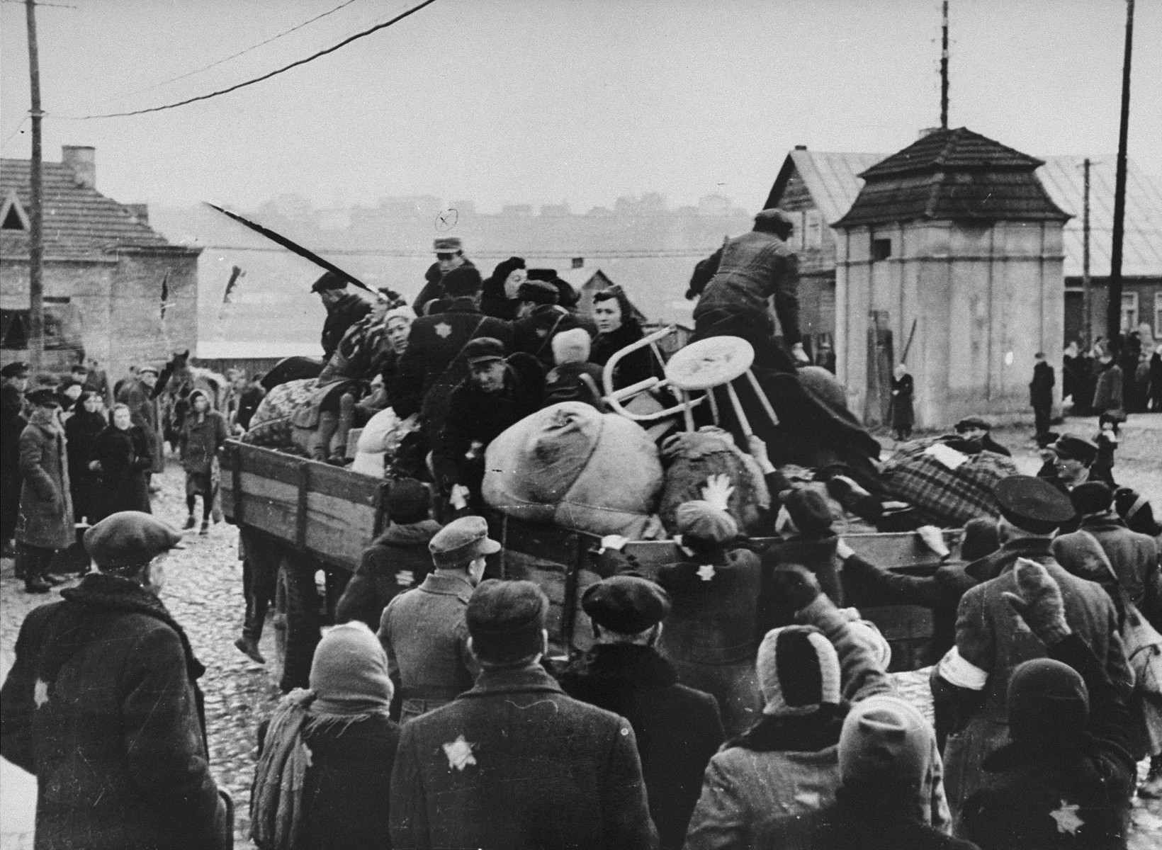 Jews in the Kovno ghetto are boarded onto trucks during a deportation action to either a work camp near Kovno or Estonia.  These Jews were sent to the Koramei concentration camp in Estonia.  Among those pictured on the truck are Moishe Fishel, Chana, Jankel, Esther and Chaim Miszelski; and Eli, Sima and Boris Rochelson.
