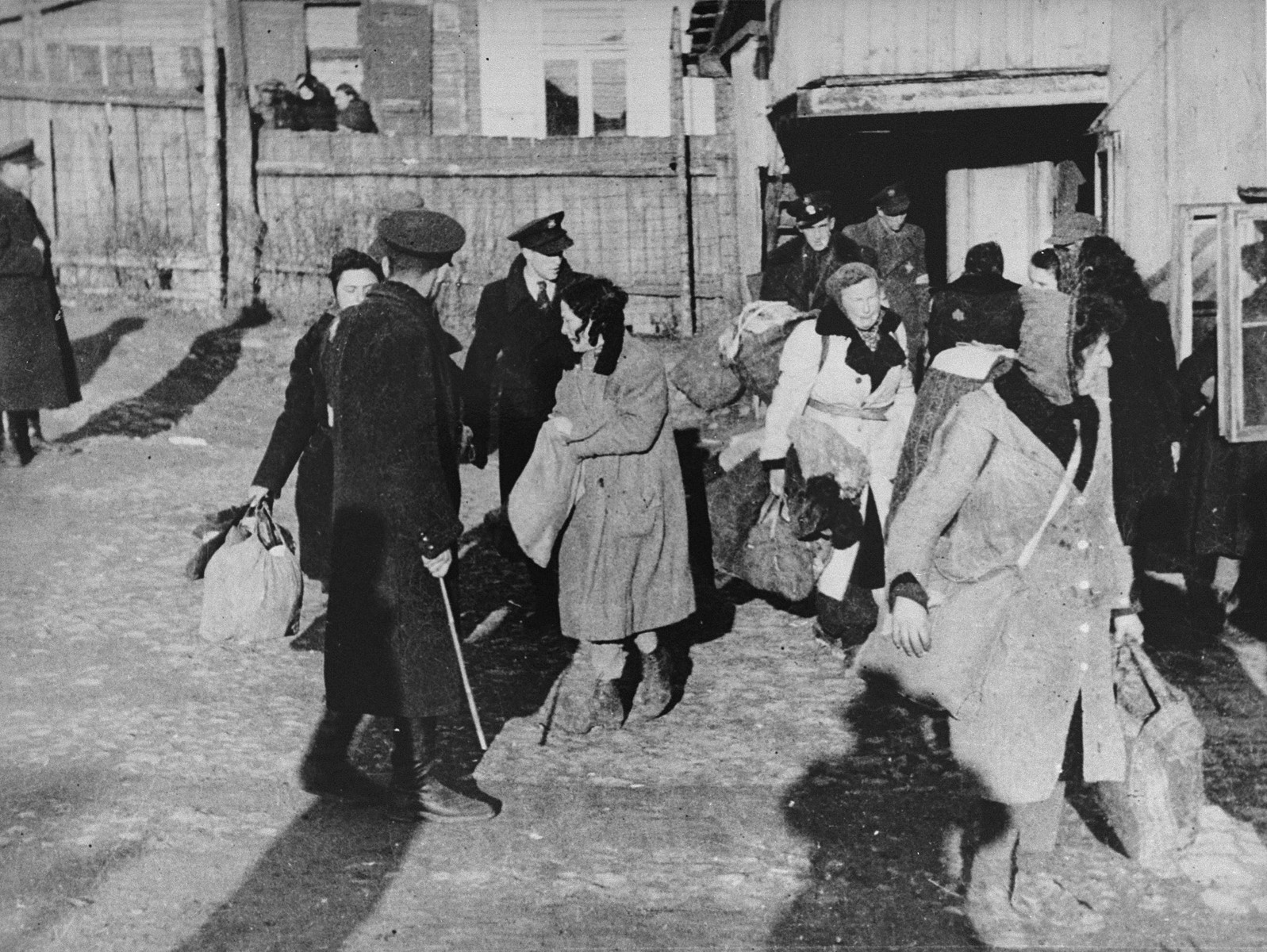"Jewish police direct people to the assembly area in the Kovno ghetto during a deportation action to Estonia.  Photographer George Kadish captioned the photo  ""Transfer to nowhere""."