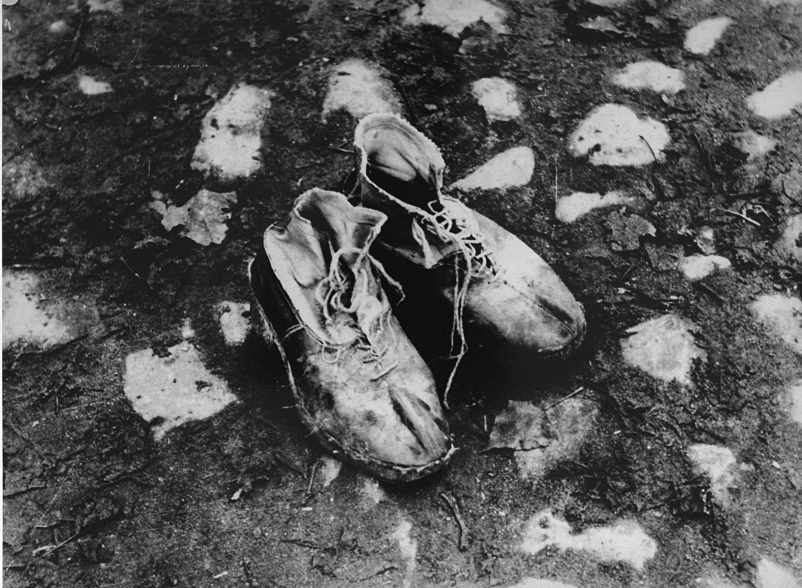 "A pair of shoes left behind after a deportation action in the Kovno ghetto.   Photographer George Kadish captioned the photo ""The body is gone""."