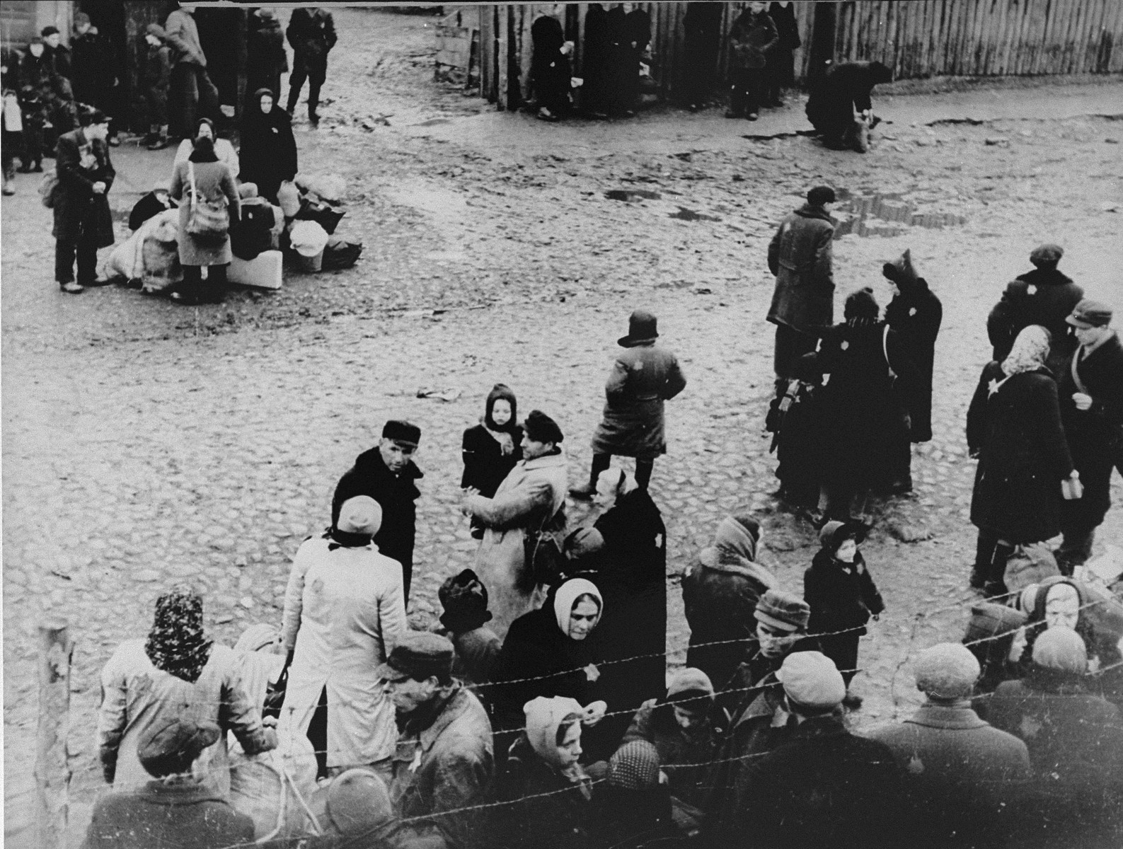 Jews are gathered at an assembly point in the Kovno ghetto during a deportation action to Estonia.