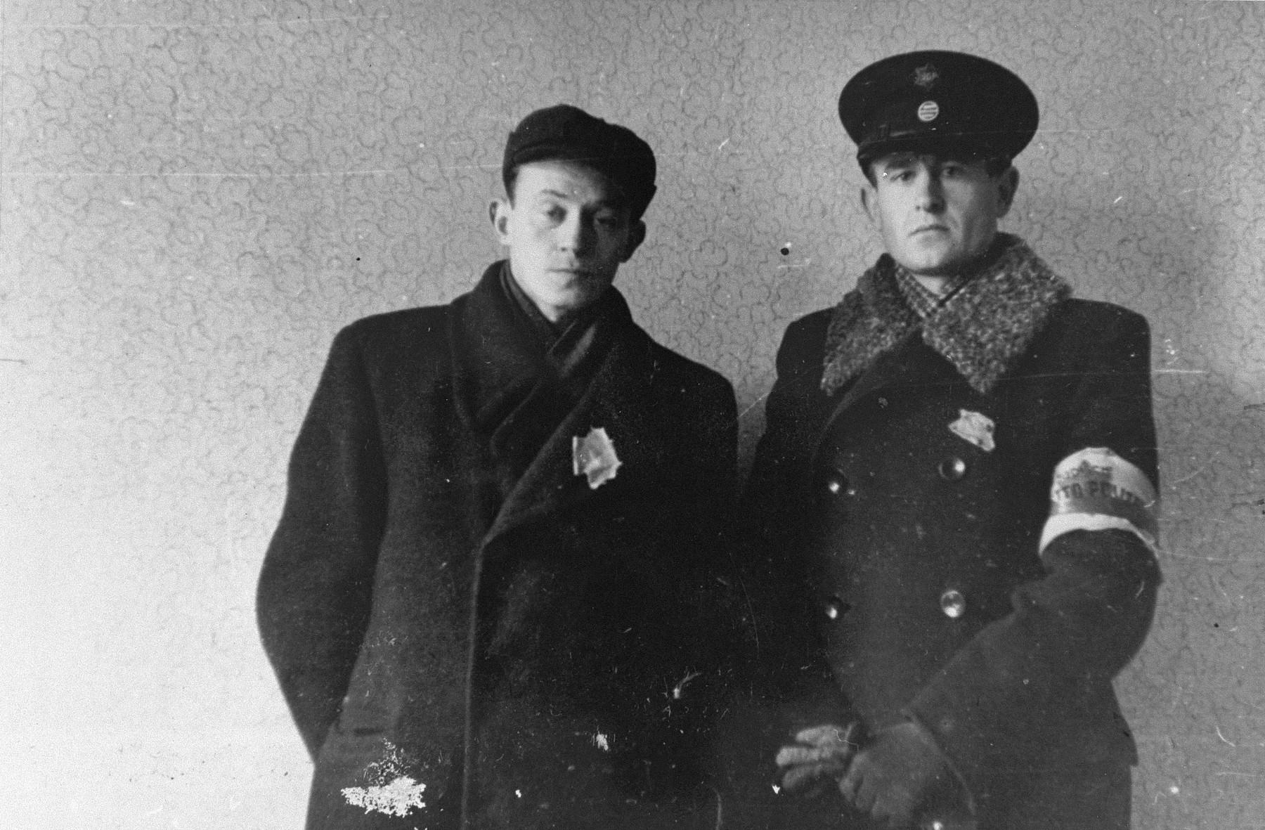 Photographer Zvi-Hirsh Kadushin (George Kadish, left) poses with deputy police chief Yehuda Zupovitz (right) in the Kovno ghetto.