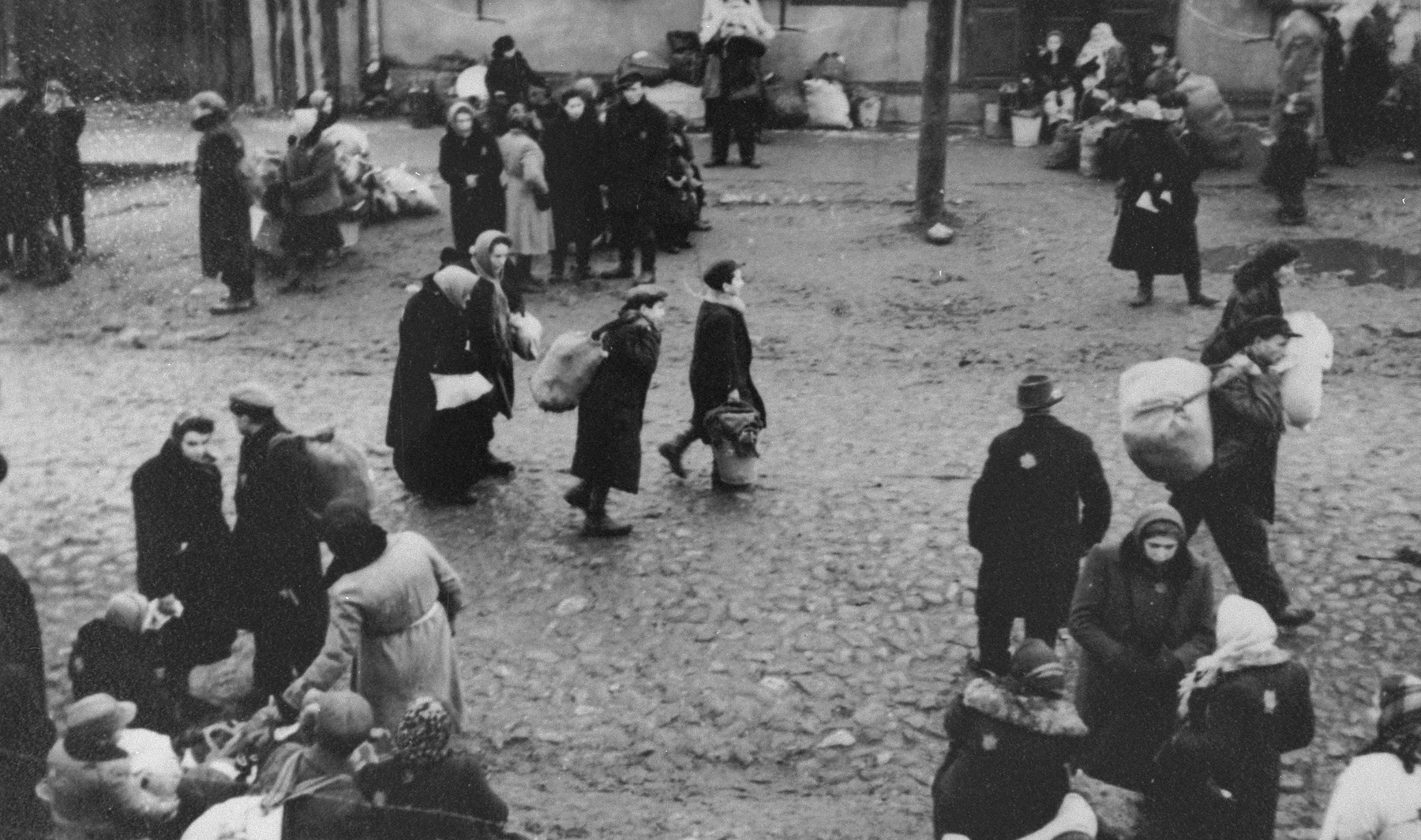 Jews are gathered at an assembly point in the Kovno ghetto during a deportation action [probably to Estonia].