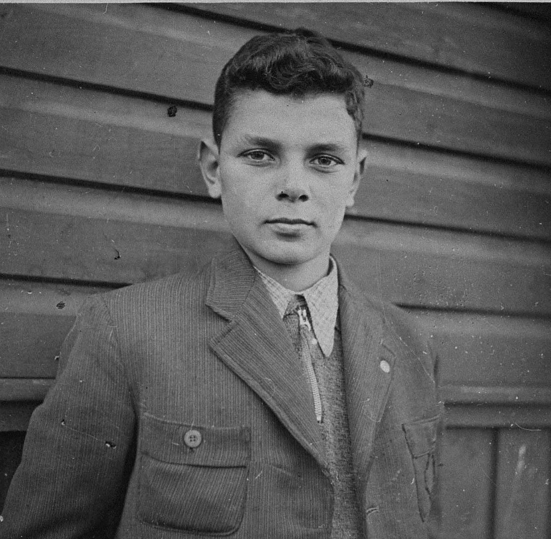 "Portrait of I. Israelowitz as a youth in the Kovno ghetto.  The inscription in Hebrew, on the back, reads: ""A momento to my friend Izio [Itzhak Zeev] Trozki from me / I. Israelowitz / October 15, 1943."""