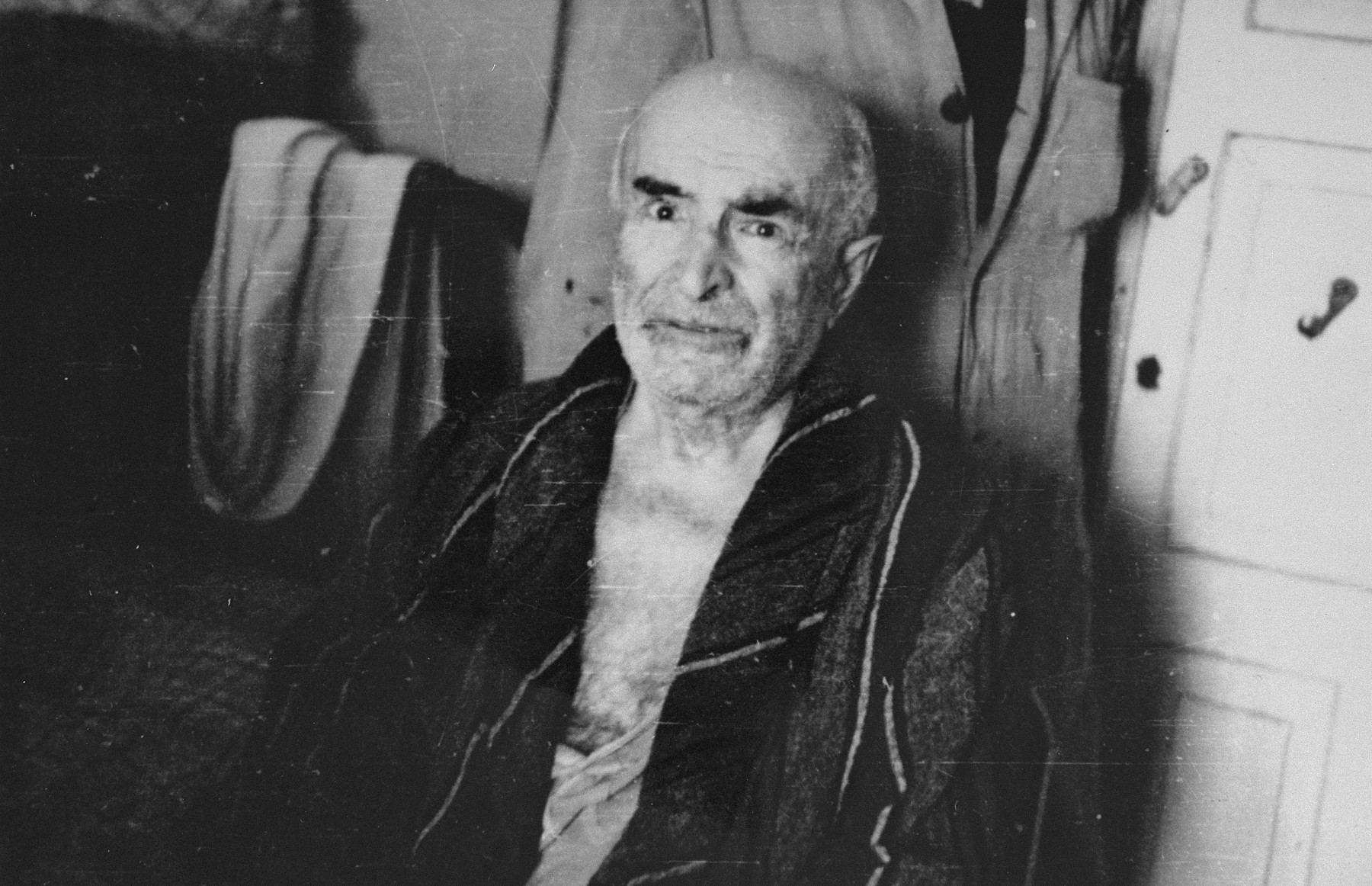 Portrait of Professor Simon Bieliatzkin in his room in the Kovno ghetto.  Before the war Bieliatzkin was a jurist and an expert in civil law at the University of Lithuania.  During the war he served as chairman of the Jewish court in the ghetto. By 1943 Bieliatzkin was suffering from severe depression and was being treated in a clandestine psychiatric unit.